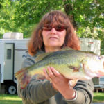 woman holding up bass