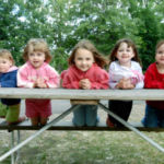 children at picnic table in mN