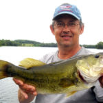 man holding bass in MN