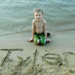 child wrote name in sand