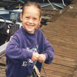 child with fish on dock