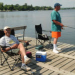 two men fishing from MN dock