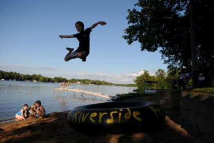 Kid leaping into the Lake