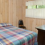 wood paneling in small bedroom