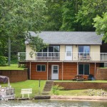 serenity shores | view of pontoon in water and lake house